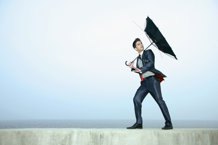 Man with Inverted Umbrella Representing Risk